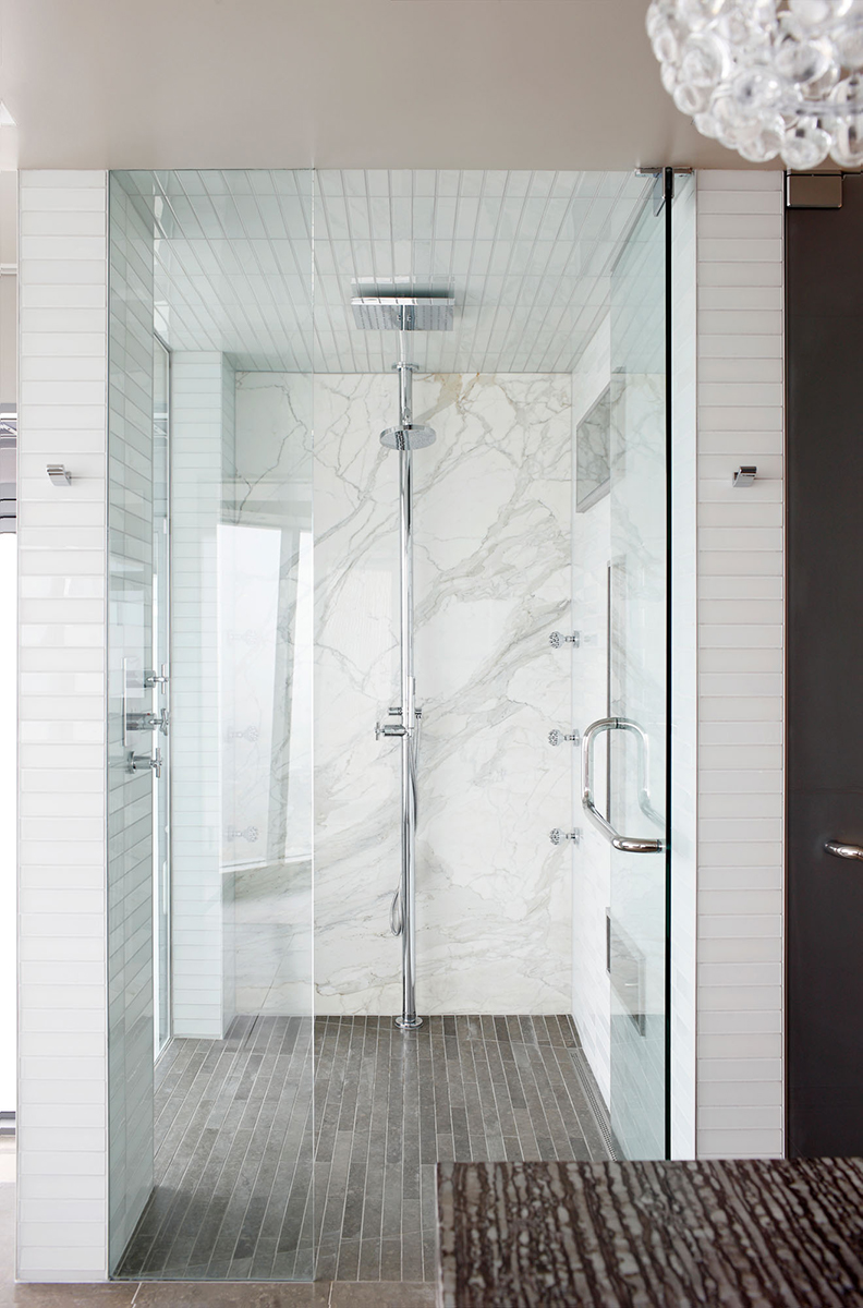 Master Bath with Calacatta Shower Walls and Striata Mocha Countertops